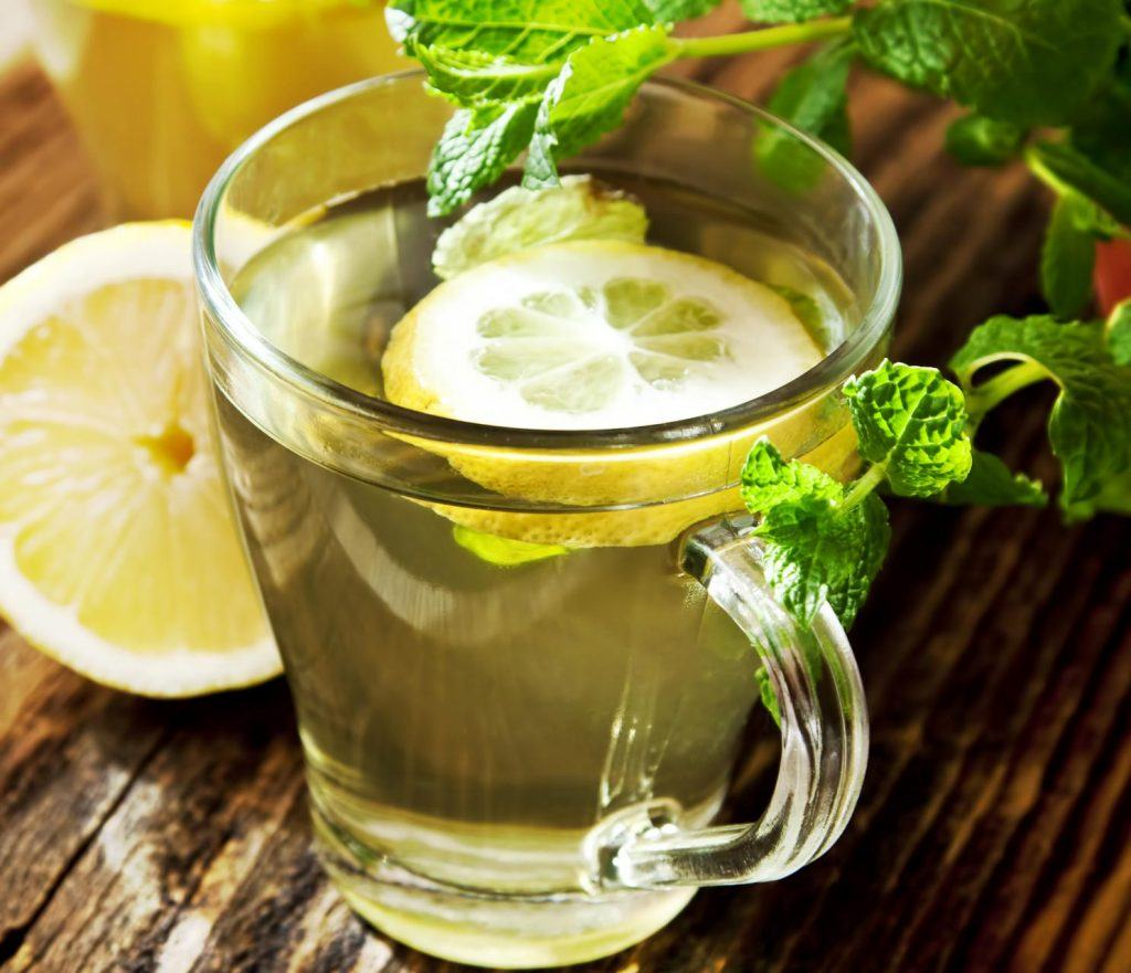 Fresh Lemon Tea with Mint Leaves in Transparent Cups