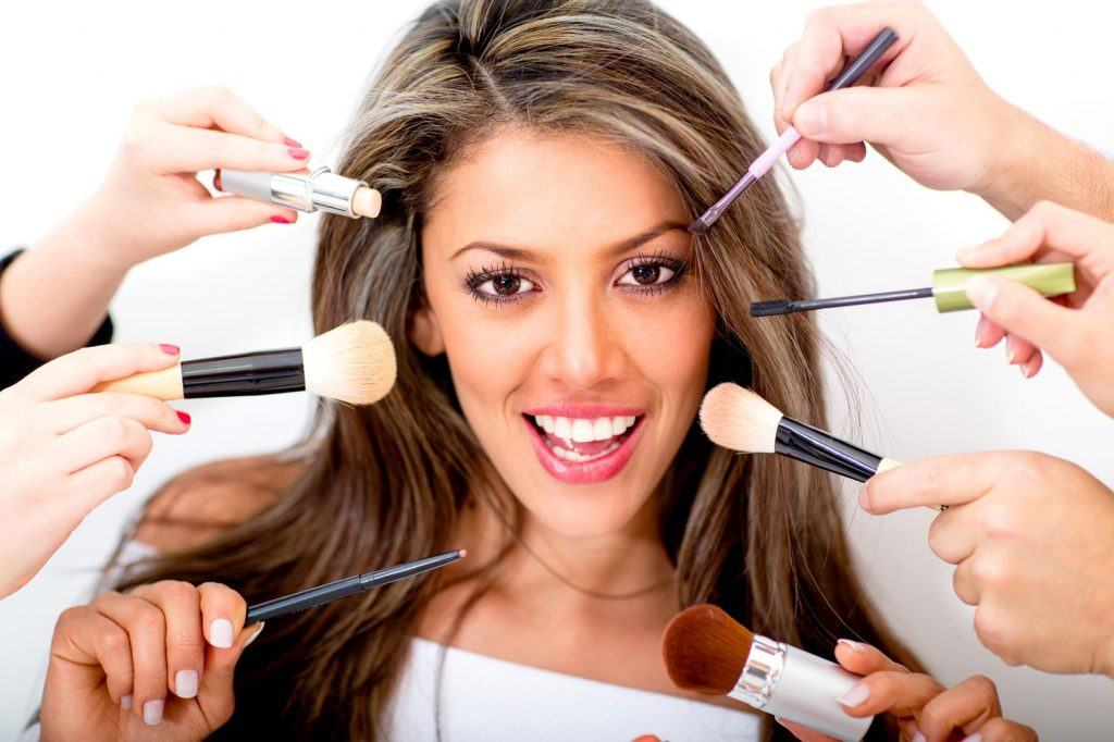 Woman at the beauty salon getting professional styling - isolated over white