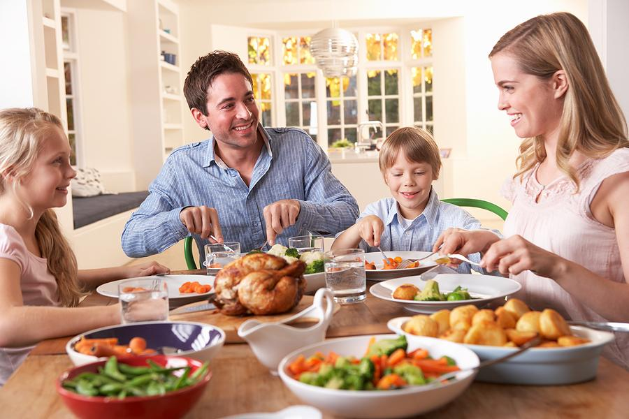 bigstock-Happy-family-having-roast-chic-139215561